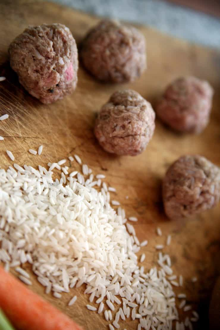meatballs on a cutting board with rice