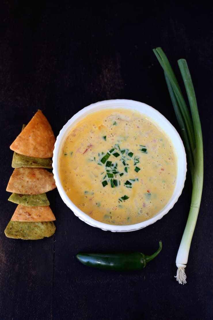 chile con queso tex-mex queso with a side of tortilla chips