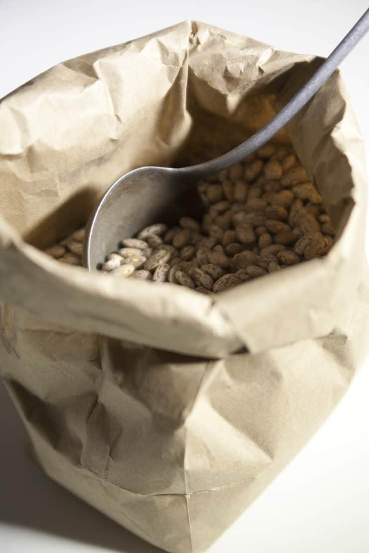 pinto beans in a paper bag to make frijole de la olla