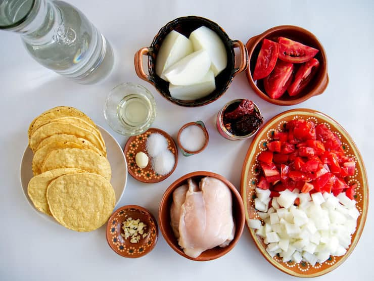 tostadas and prepped ingredients to make chicken Tinga