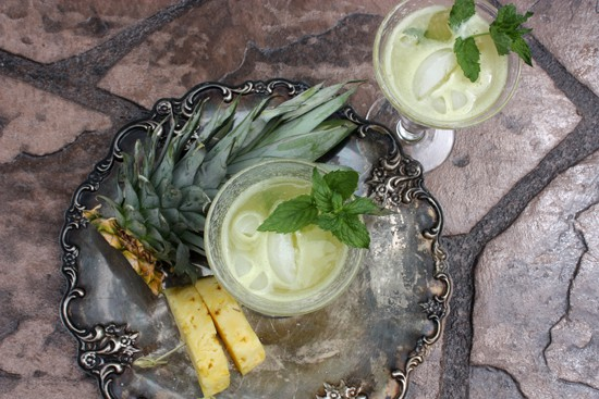 Overhead on the mouthwatering Agua de Piña or Pineapple Cooler served on an impressive metal tray
