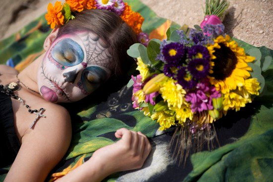 girl with rosary day of the dead and flowers