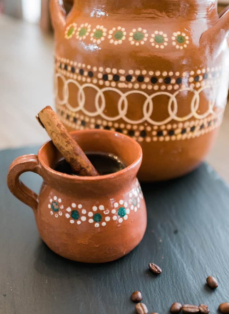 cafe de olla in clay Mexican pottery with a Mexican cup and cinnamon stick