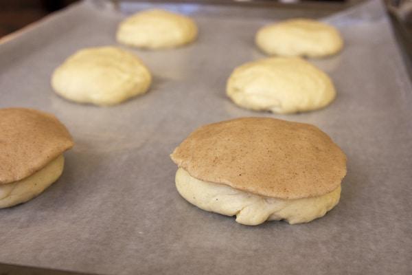 conchas pan dulce assembled on parchment paper