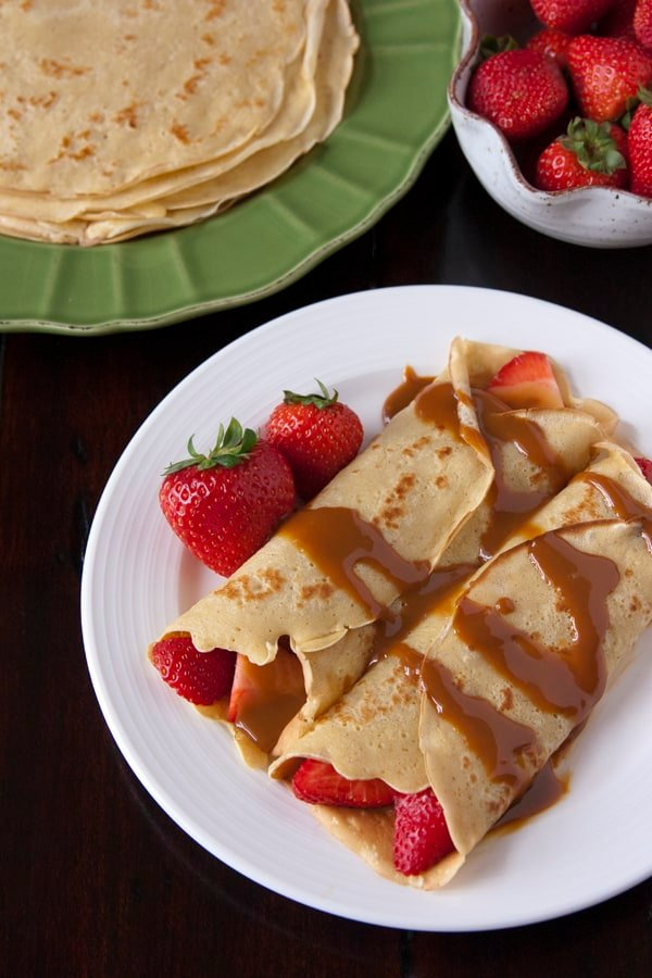 Strawberry-Filled Crepes Drizzled with Boozy Dulce de Leche