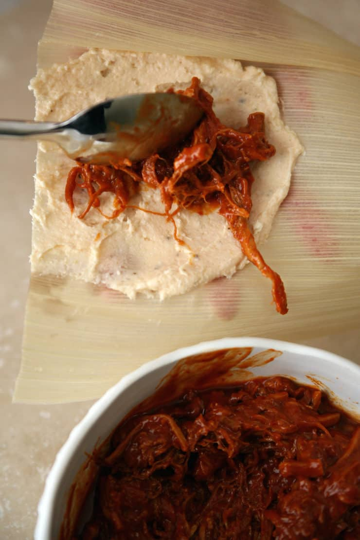 how to assemble tamales Red Chile pork filling on masa