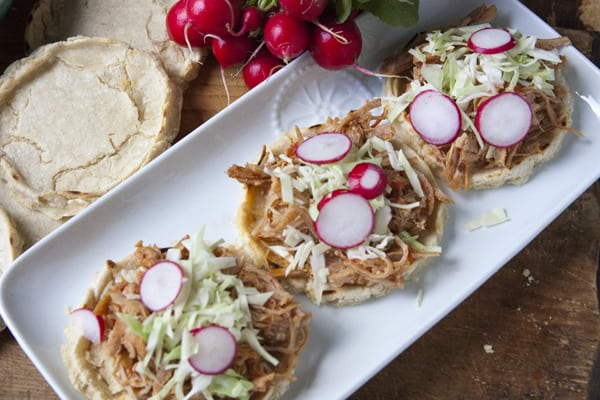 Pork Tinga sopes cabbage radishes