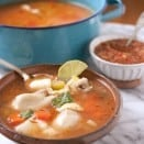 Caldo de Pollo Homemade Chicken Soup in a teal pot