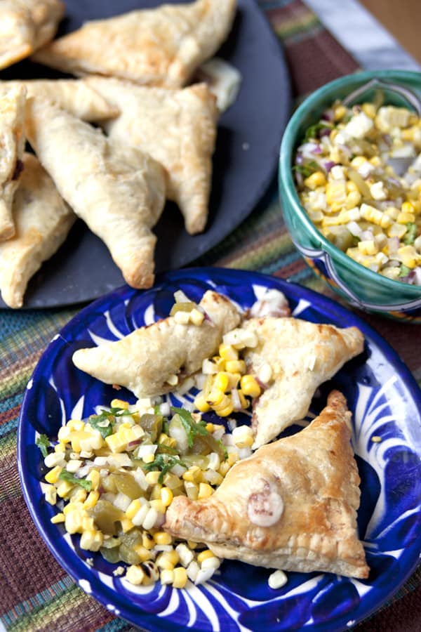 savory refried beans empanadas with corn salsa