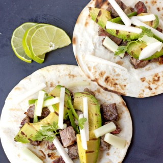 Steak Tacos with Cucumber-Jicama Salsa and grilled avocado slices