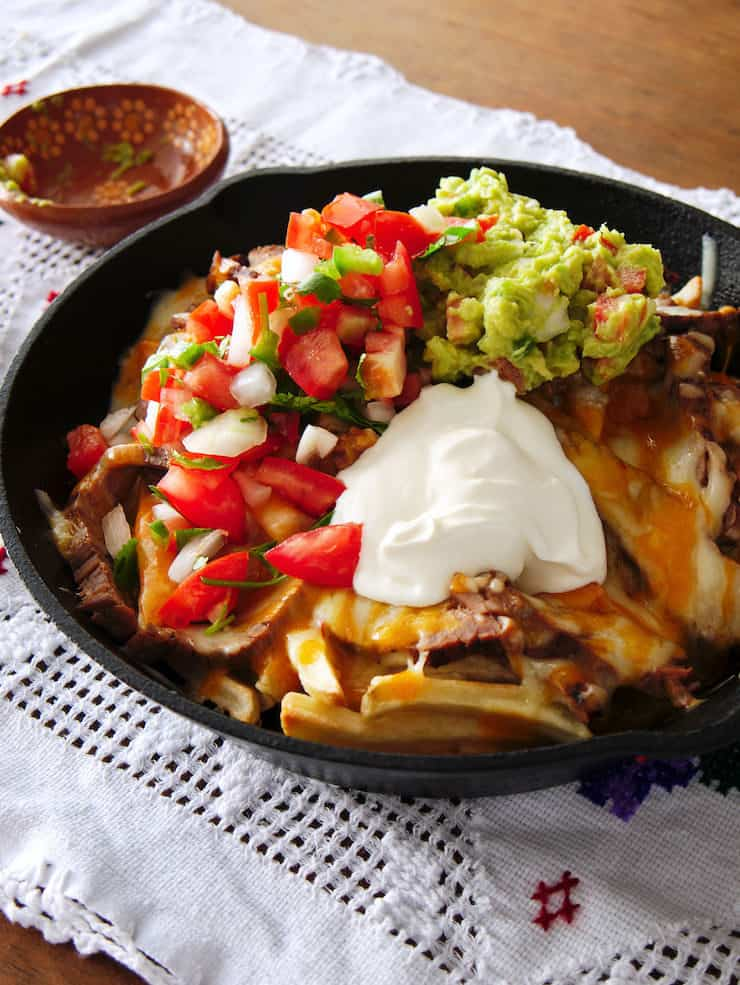 Carne Asada fries recipe in a cast iron skillet