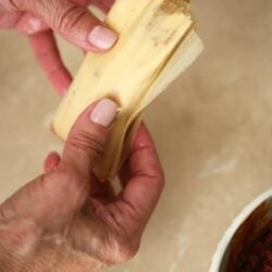 Making tamales masa with two hands