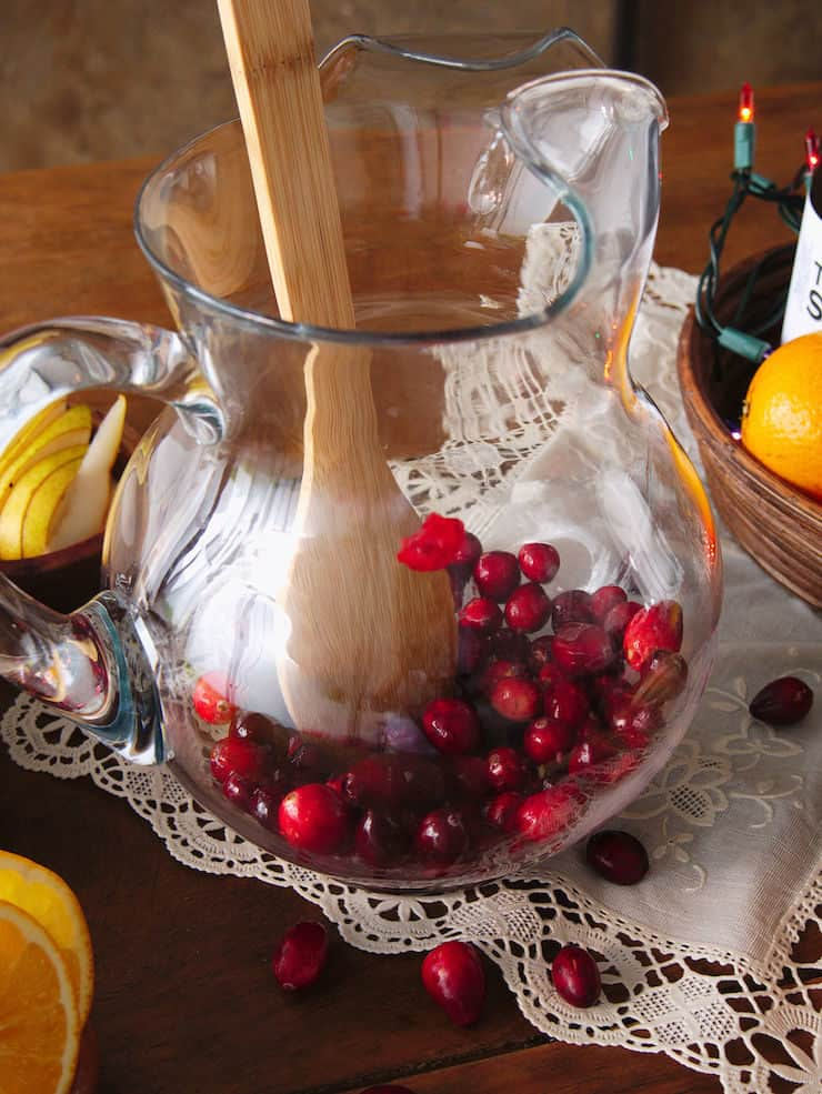 muddle cranberries in pitcher to make sangria