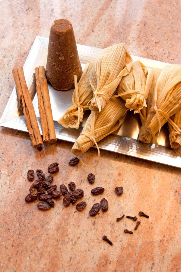 raisin filled tamales with Canela