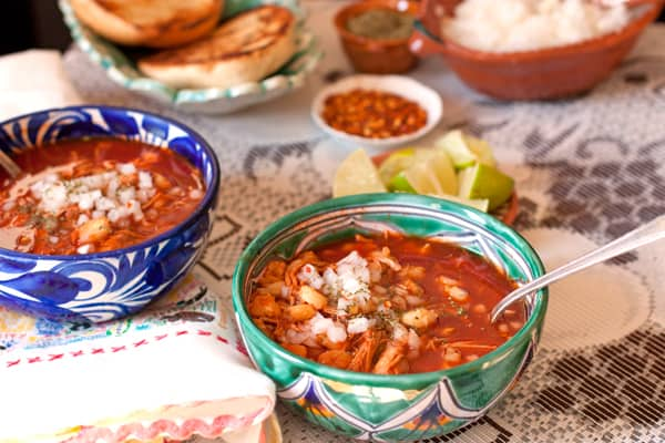 Pozole Rojo in two Mexican pottery bowls on table