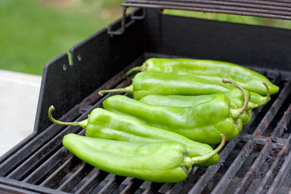 hatch green Chile on a grill roasting