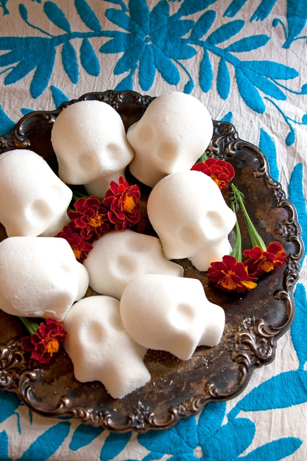sugar skulls on a platter with marigolds how to make DIY