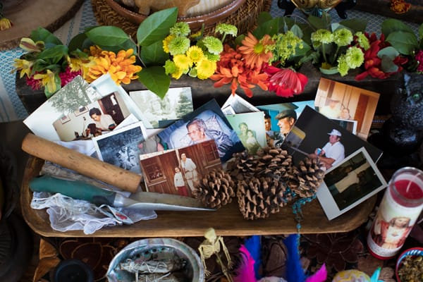 photos on day of the dead altar and personal belongings