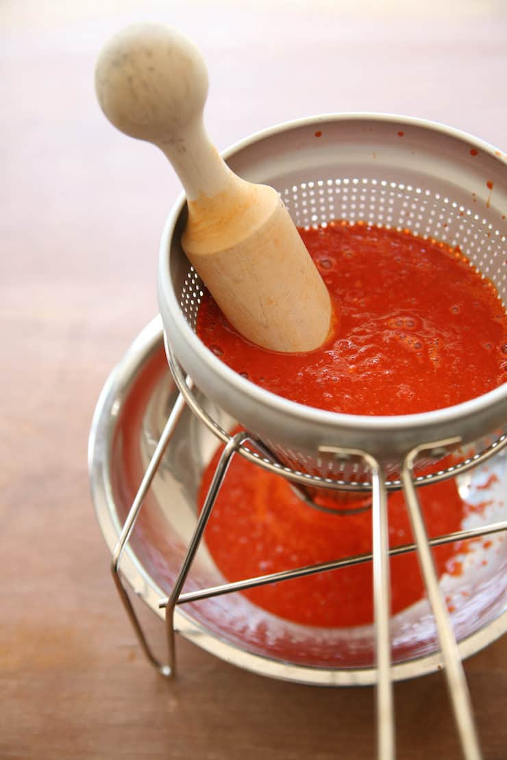 red Chile sauce in a sieve