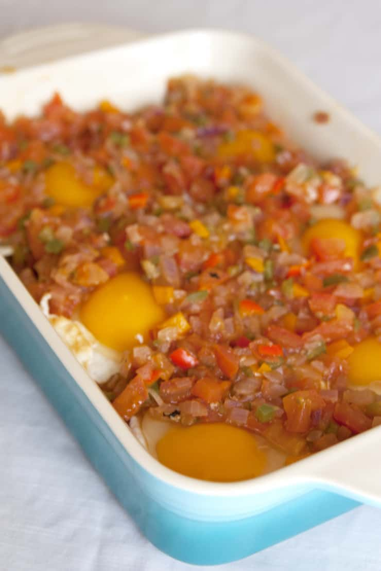 Baked Egg Casserole (Cazuela de Huevos) smothered with warm salsa
