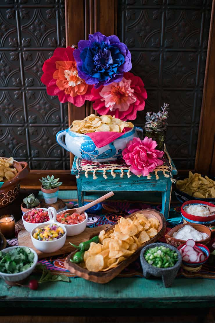 kettle-chip nachos for cinco de mayo nacho bar with colorful paper Mexican flowers