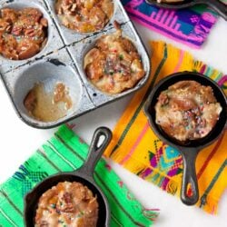 Capirotada Muffins served in cute mini pans on colorful pieces of fabrics