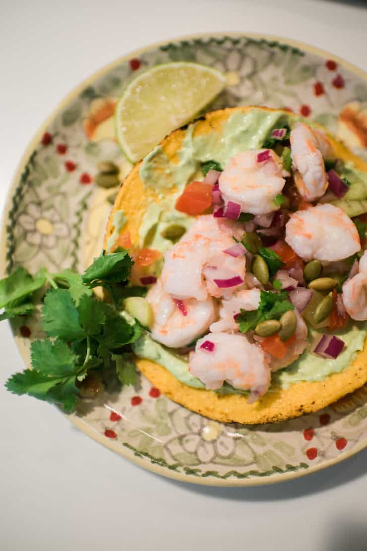 a close up plate of a tostada with Shrimp Ceviche (Ceviche de Camarón)