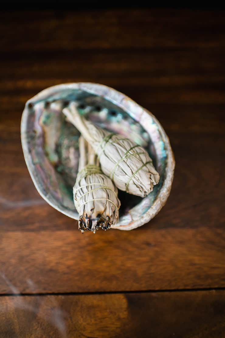 how to smudge your home burning sage smudge sticks in a abalone shell