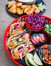 beer battered baja fish tacos on a red platter