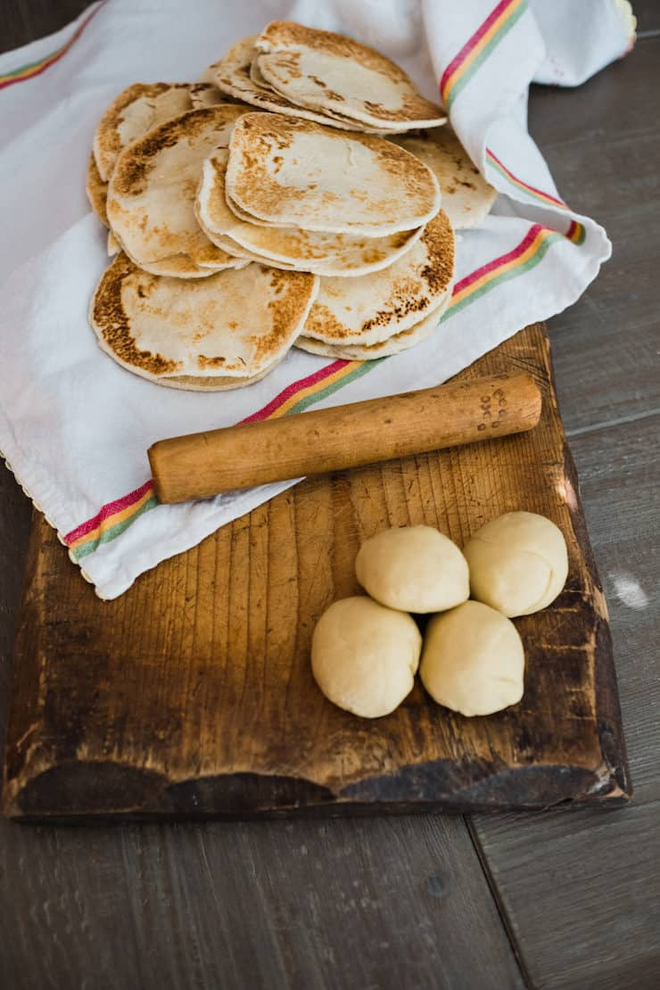 Flour gorditas recipe - some are in balls waiting to be rolled out and cooked, some are completed