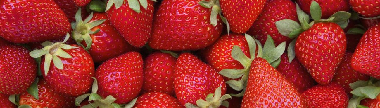 fresh strawberries in a pile