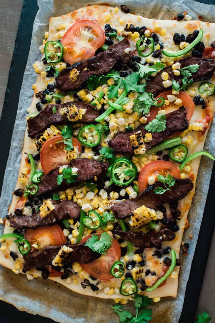Overhead shot of Carne Asada and Roasted Corn Taco Pizza