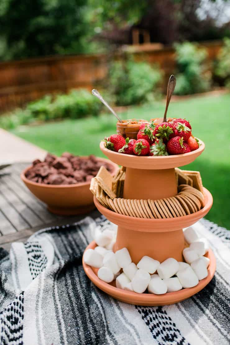 S'mores Bar Party | build your own s'mores party table with terra-cotta clay pots and lava rocks