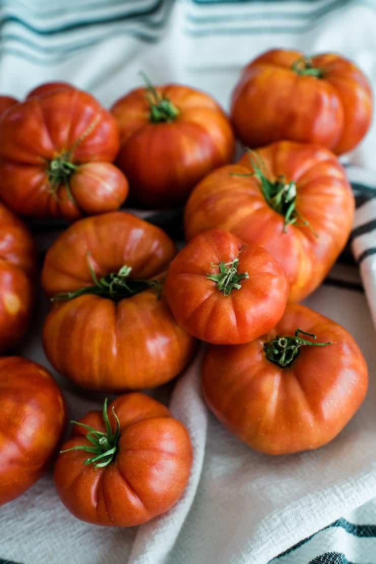 fresh tomatoes on a white linen