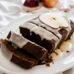 chocolate bread with bourbon glaze on a white plate