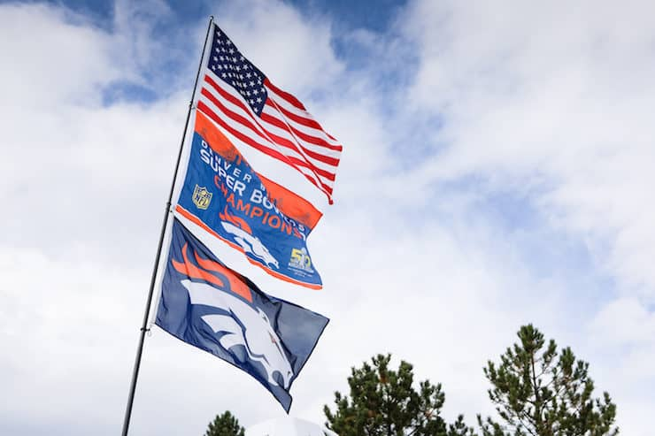 Denver broncos super bowl champions and US flag blowing in the wind