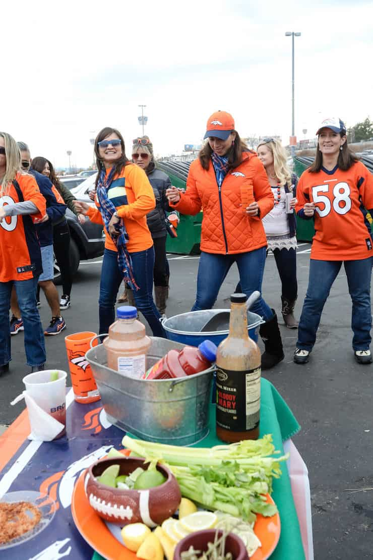 Denver Broncos fans dancing at a tailgate