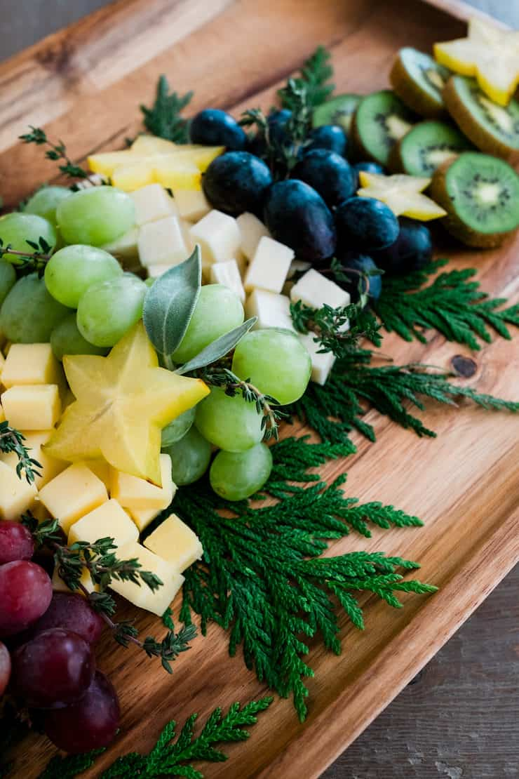 Christmas Tree Cheese Board closeup of star fruit sliced with grapes and kiwi