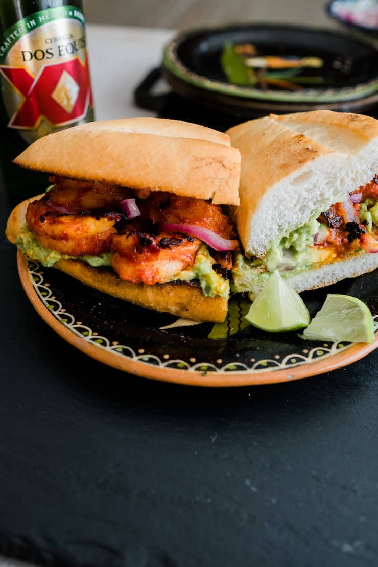 spicy shrimp torta sliced in half on a painted ceramic plate