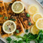 Lemon Butter Fish served with lemons and herbs