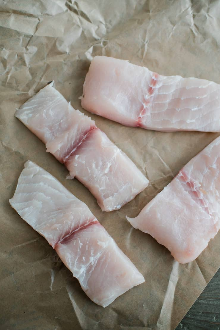 Four pieces of raw fish ready for cooking