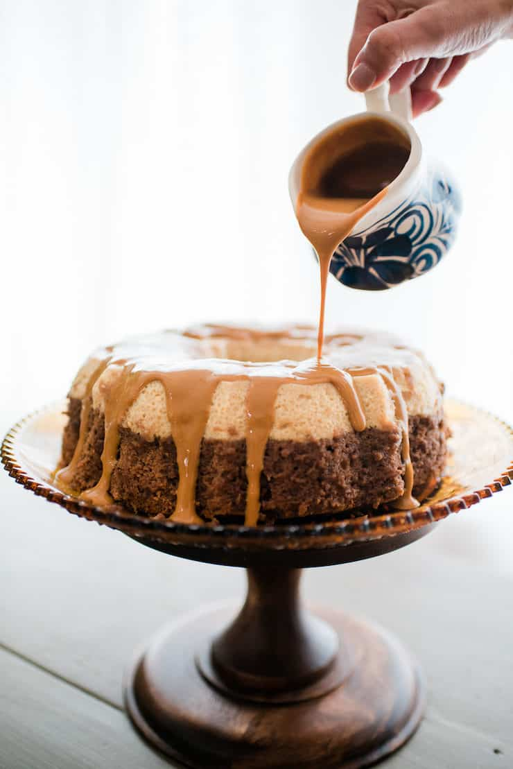 Pouring deliciousness over the Homemade Chocoflan