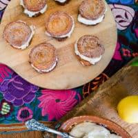 Churro Lemon Cream Sandwiches served on a wooden board