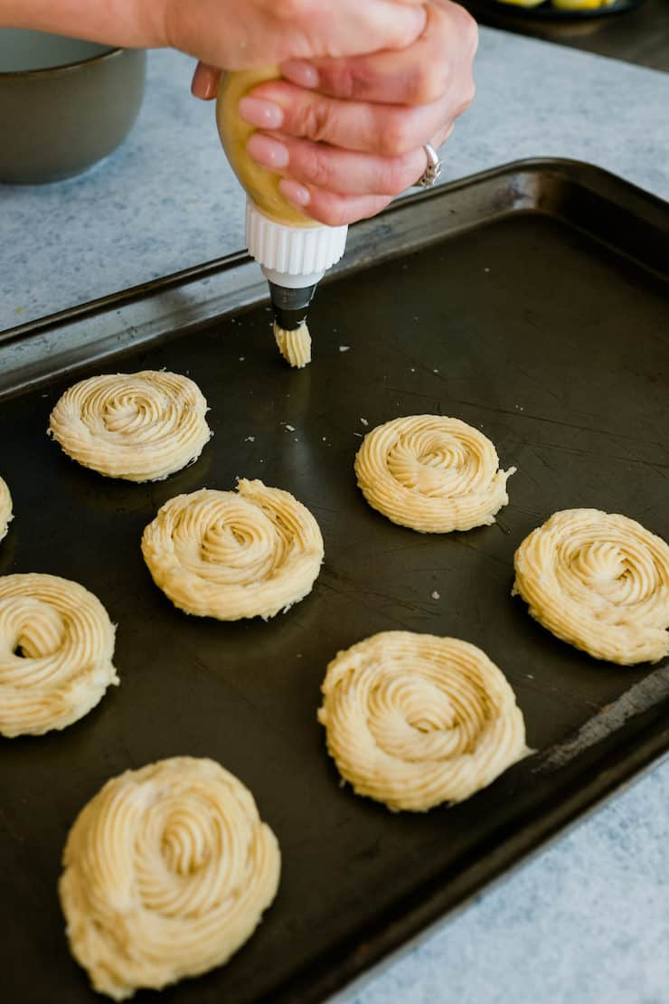 Piping the churros dough on a tray