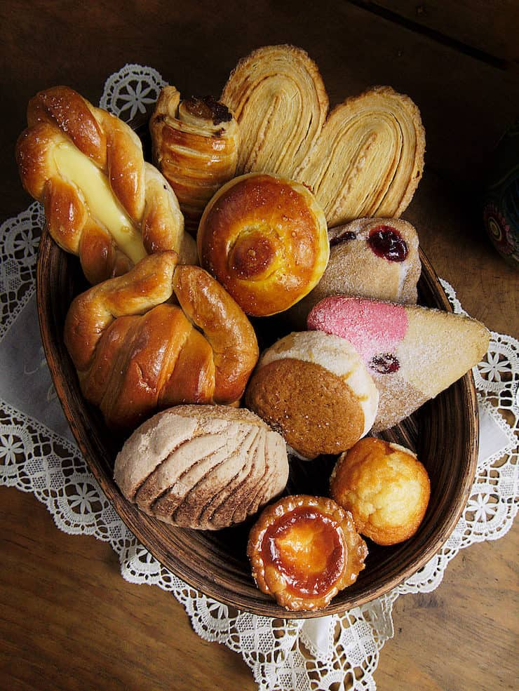 Mexican pan dulce from A to Z basket with an assortment of sweet bread