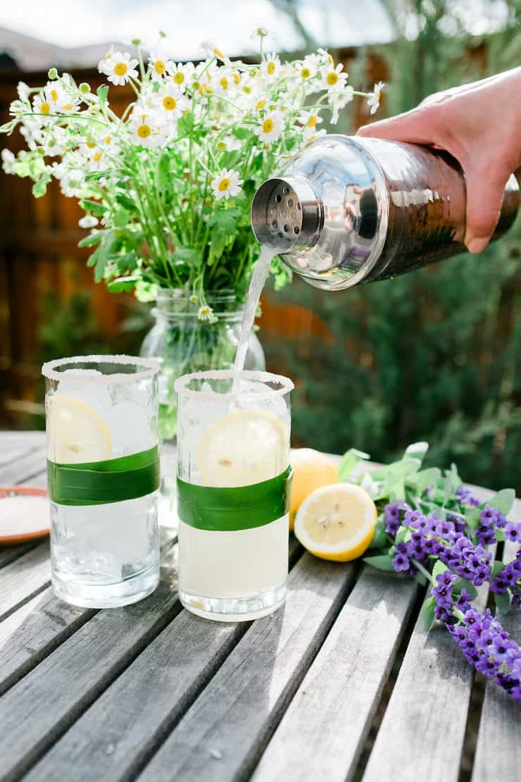 Pouring Lavender Lemon Margarita into two glasses