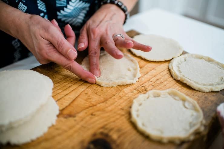 pinching warm dough to form sopes -- Homemade sopes are the best