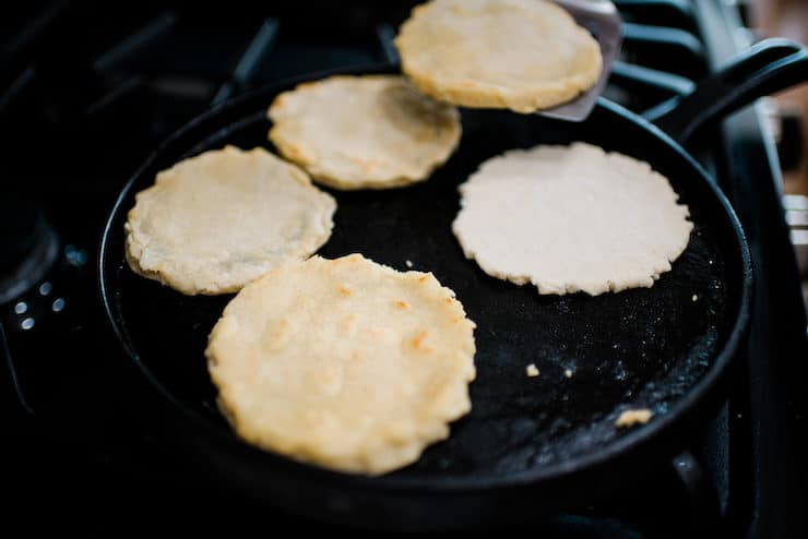 Cooking sopes on a comal
