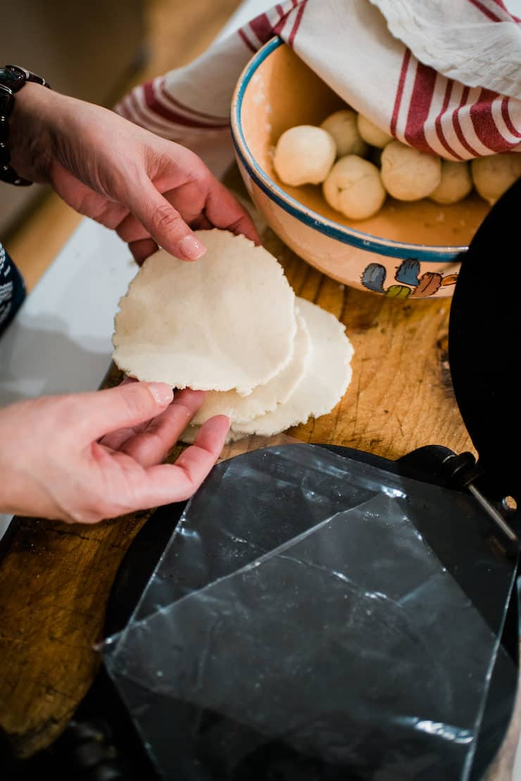 Holding masa tortillas sopes in hands before forming