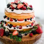 A tall lemon buttermilk spring fling cake served extra inviting